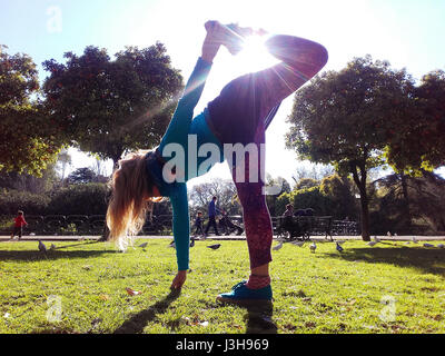 SPAIN, SEVILLE: Claudia is a professional yoga teacher, currently teaching outdoor yoga classes in Seville. - Stock Photo