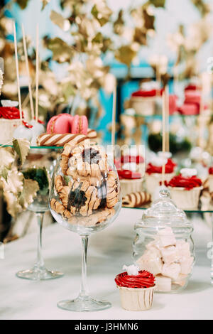 Dessert Sweet Tasty Cupcakes, Cookies In Candy Bar On Table. Delicious Sweet Buffet. Wedding Decorations - Stock Photo
