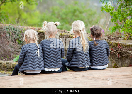 Four girls with equal clothing and hair-style, Germany, Europa - Stock Photo