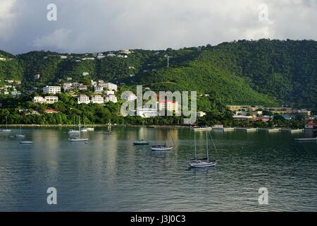 St Thomas island view from water with sun patches over hills and water. - Stock Photo