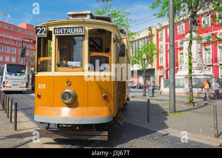 Porto tram Portugal, view in summer of a tram passing through the Praca da Batalha in the center of Porto, Portugal, - Stock Photo