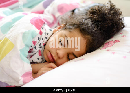 Beautiful girl sleeping during the day - Stock Photo