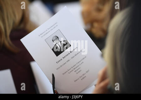 A mourner holds the order of service ahead of the funeral of Leslie Rhodes, who died in the Westminster attack, - Stock Photo