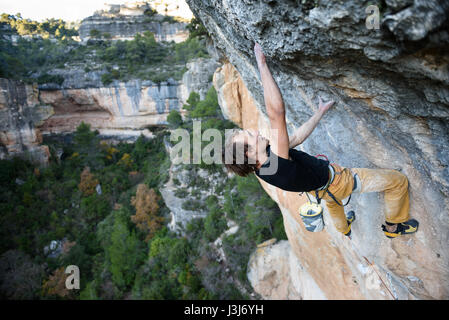 Extreme sport climbing. Rock climber struggle for success. Outdoor lifestyle. A person trying hard to reach sucsess. - Stock Photo