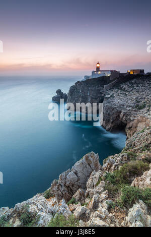 View of the lighthouse and cliffs at Cape St. Vincent at sunset. Continental Europe's most South-western point, - Stock Photo
