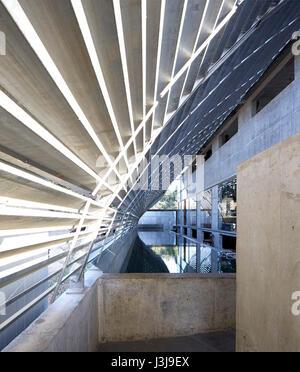 Entrance area under steel canopy with pool. The Pool Studio of Matharoo Associates, Ahmedabad, India. Architect: - Stock Photo