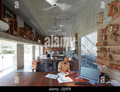 Interior studio view with design principle, Gurjit Matharoo, in foreground. The Pool Studio of Matharoo Associates, - Stock Photo