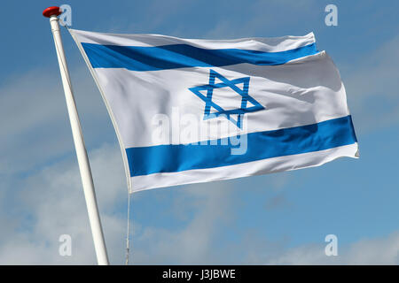 Israeli flag flying in the wind - Stock Photo