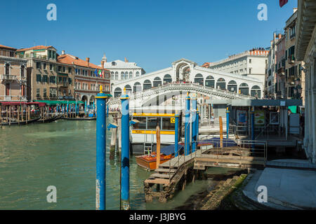 Spring afternoon on Grand Canal in Venice. Rialto Bridge in the distance. - Stock Photo