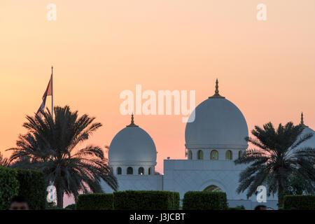 United Arab Emirates - Orange skies over Sheikh Zayed Mosque in Abu Dhabi - Stock Photo
