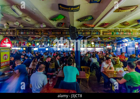 BRUSSELS, BELGIUM - 11 AUGUST, 2015: Famous Delirium Bar inside overview of crowded room of people enjoying their - Stock Photo