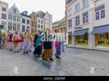 BRUSSELS, BELGIUM - 11 AUGUST, 2015: Hare Krishna street performers dancing in city centre. - Stock Photo