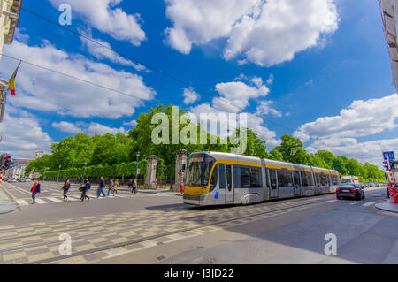 BRUSSELS, BELGIUM - 11 AUGUST, 2015: Blue tram passing by Palace of the Nation on a beautiful sunny day. - Stock Photo