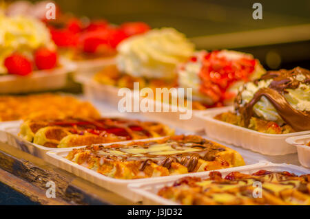 BRUSSELS, BELGIUM - 11 AUGUST, 2015: Famous belgian waffles as displayed in store with cream, berries and chocolate - Stock Photo