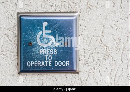 Handicap door opener - Stock Photo