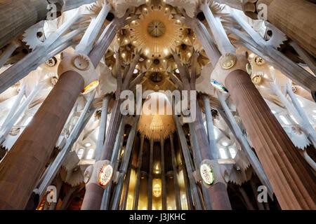 Inside La Sagrada Familia, Barcelona Spain. God and the apex of the interior. - Stock Photo