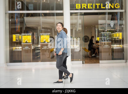 People walk past a Breitling retail store in New York on Saturday, April 29, 2017. CVC Capital Partners, a private - Stock Photo