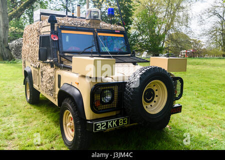 British army military police landrover with desert camouflage. - Stock Photo