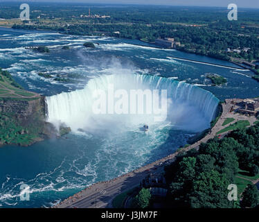 Niagara Falls and Maid of the Mist pleasure boat, Ontario, Canada - Stock Photo