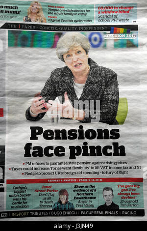 Prime Minister Theresa May on front page of the i Weekend Independent newspaper headline 'Pensions face pinch' 23 - Stock Photo