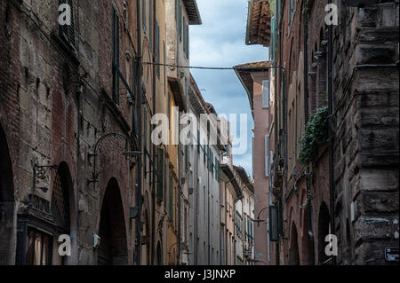 Narrow street with typical Italian houses in Lucca, Tuscany, Italy - Stock Photo