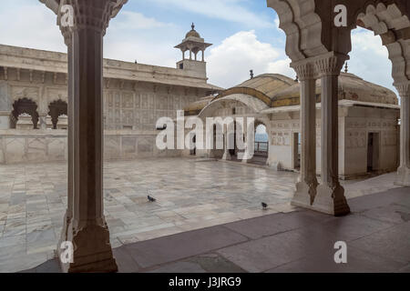 Royal palace with white marble architecture carvings at Agra Fort - A UNESCO World heritage site. - Stock Photo