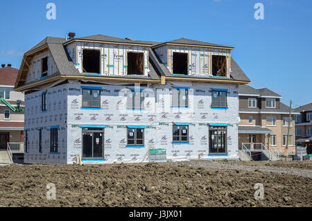 Montreal, Canada - April 29, 2017: A new stick built home under construction - Stock Photo