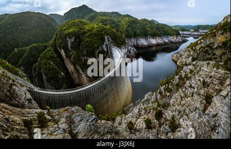 198m long and 140m high Gordon Dam in Southwest Tasmania - Stock Photo