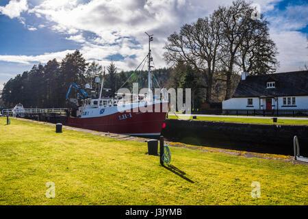 Kytra lock with motor vessel, Caledonian Canal, Highlands, Scotland, UK. - Stock Photo