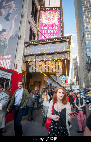 Throngs of theatergoers descend on the Imperial Theatre on Broadway in New York to see a performance on Tuesday, - Stock Photo