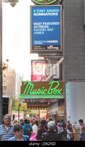 Throngs of theatergoers descend on the Music Box Theatre on Broadway in New York to see a performance on Tuesday, - Stock Photo