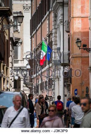 Italian and European Union flags on poles from a balcony, Municipio I, Rome, Lazio, Italy - Stock Photo