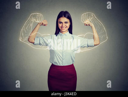 Powerful confident woman flexing her muscles isolated on gray wall background. Human face expressions, emotions - Stock Photo