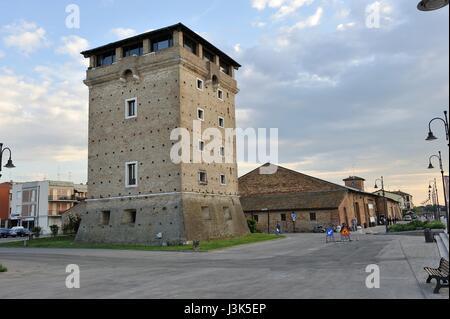 San Michele tower and the old salt deposit and Salt Museum, salt flats, Cervia, Emilia Romagna, Italy - Stock Photo