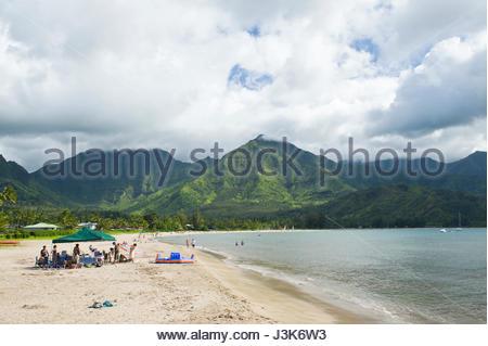 The Namolokama Mountain rises in the background of Hanalei beach and bay, Kauai, Hawaii, USA - Stock Photo