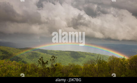 Stormy and ominous skies give way to a vibrant, beautiful rainbow over the Shenandoah Valley - Stock Photo