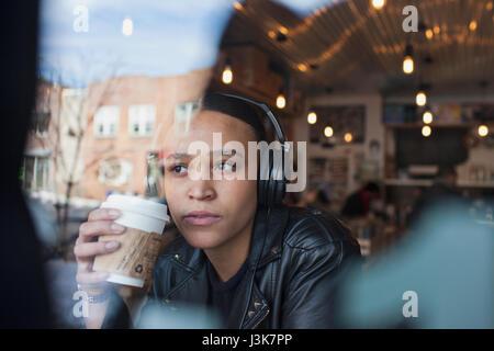 Young woman wearing headphones. - Stock Photo