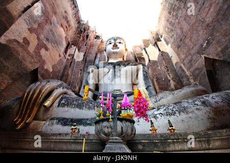Giant statue of Buddha call Phra Achana in Wat Si Chum at Sukhothai Historical Park, Thailand - Stock Photo