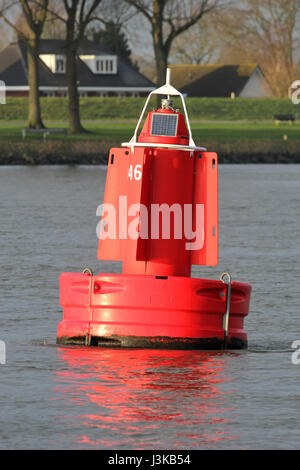 lateral buoy at the edge of a fairway - Stock Photo