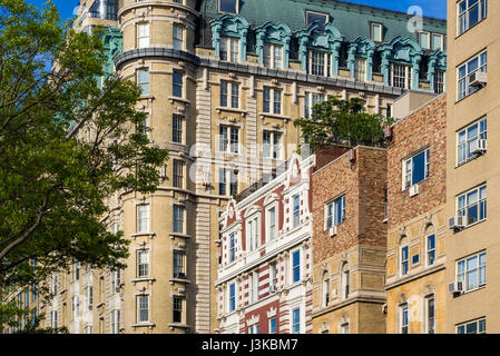 Facades of high-rise buildings on Central Park West. Upper West Side on sunny morning. Manhattan, New York City - Stock Photo