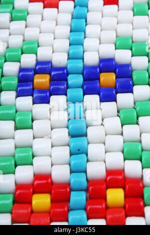 Retro vintage barrel glass beads. Beading flower hobby close up photo. - Stock Photo