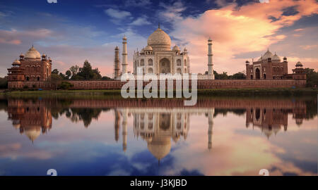 Taj Mahal sunset view from the banks of Yamuna river. Taj Mahal is a white marble mausoleum designated as a UNESCO - Stock Photo