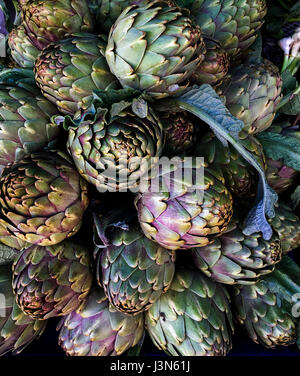 Artichokes on farmers market in the south of Mediterranean - Stock Photo