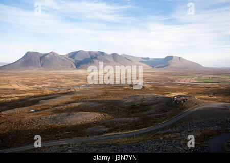 Beautiful landscape in Iceland. Countryside with light and mountain range. - Stock Photo