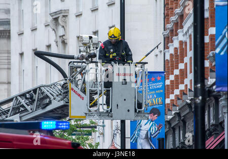 London, UK. 6th May, 2017. Early afternoon emergency services tackled a high rise fire in central London's Long - Stock Photo