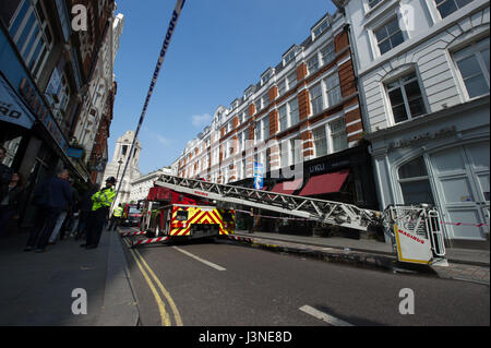 London, UK. 6th May, 2017. Fire on Long Acre near Covent Gardens, London. Several fire engines attended the fire - Stock Photo