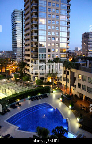 Barcelona, Spain. 6th May, 2017. Luxury skyscrapers with swimming pool in Barcelona's Diagonal Mar district at dusk - Stock Photo