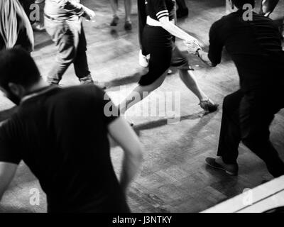Swing dancers in a ballroom black and white and vintage photo - Stock Photo