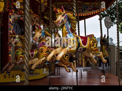 Merry-go-round carousel on the South Bank in London - Stock Photo
