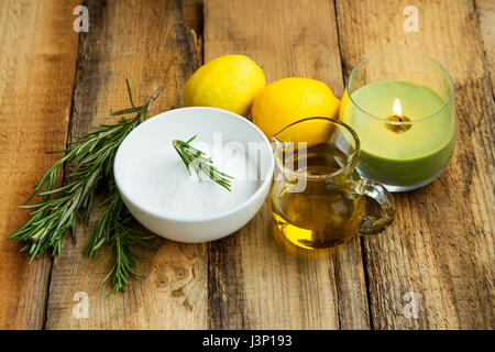 Natural homemade skincare products with baking soda, lemon, rosemary herb, olive oil, organic skincare - Stock Photo